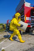 Man with briefcase in protective hazmat suit poster