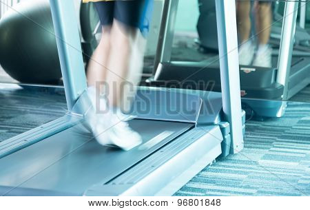 Unknow Woman Running With Treadmill With Motion Of Speed
