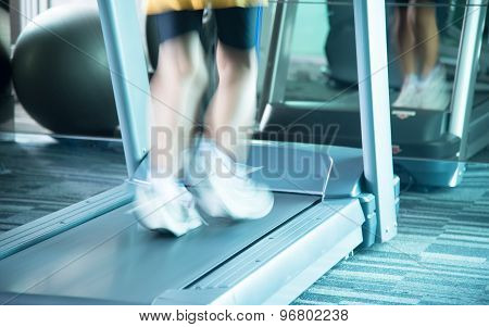Woman Running With Treadmill With Motion Of Speed
