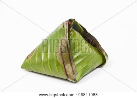 Simple and authentic nasi lemak wrapped in banana leaf, popular food in Malaysia