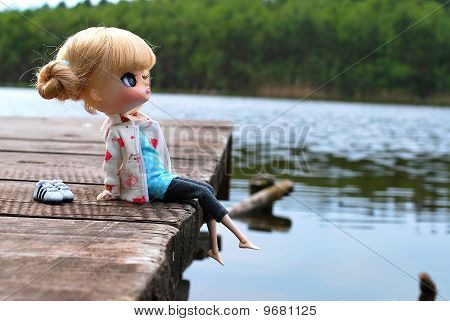 Doll sitting on a platform