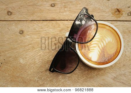 Coffee With Sun Glasses On Background Of Wooden.