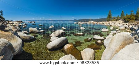 Beautiful boulders and crystal clear water of the lake Tahoe. Hidden Beach, Lake Tahoe - Nevada, USA. Panoramic photo poster
