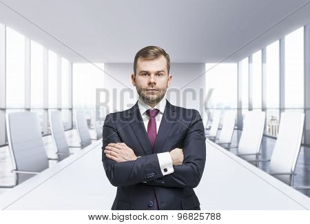 Confident businessman with crossed hands. Panoramic meeting room. New York view poster