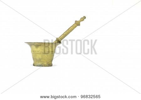 Old golden pestle and mortar