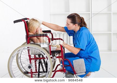 nurse comforting crying little girl