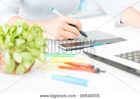 Close Up Designer Using Graphic Tablet Design On Desk