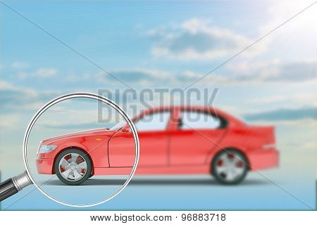 Red car under loupe