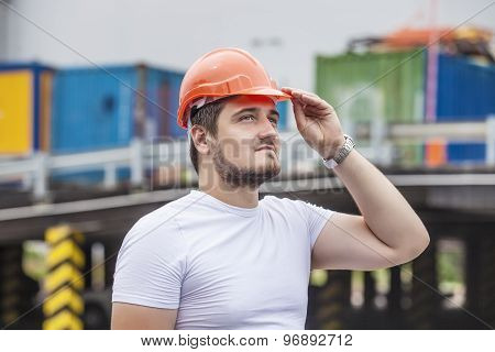 Man The Builder Working Foreman In The Helmet To Ensure Safety On The Construction Site