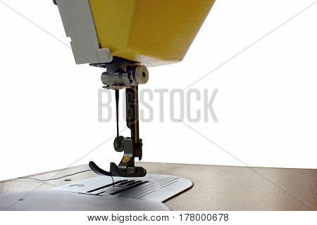 sewing machine on white background ,  machine foot and needle with red thread closeup , small part