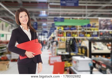 Young happy smiiling businesswoman doing apprenticeship in a supermarket