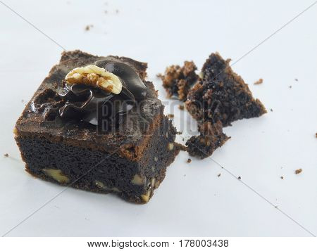 brownie with crumbs on the white background