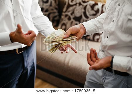 friends counting money  businessman holding many money