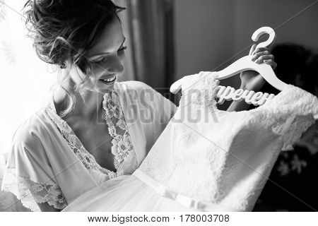 beautiful portrait of gentle and happy bride in white dress