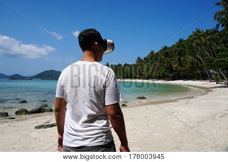 Man in Virtual Reality Glasses on Tropical Beach in Thailand
