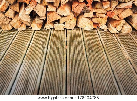 chopped firewood stack at the wooden floor image