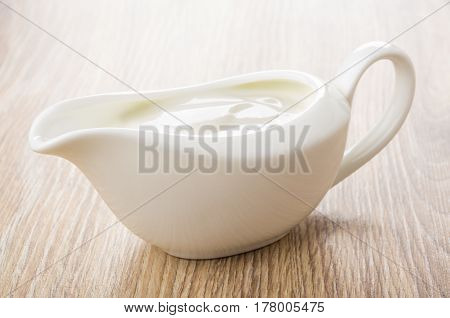 White Gravy Boat With Sour Cream On Table