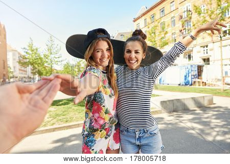 Smiling Woman Reaching Out To Touch Her Boyfriend