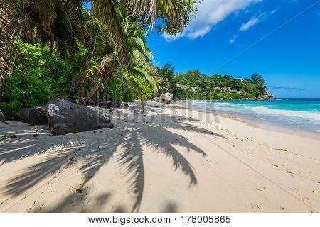 Sunny day on Anse Carana Beach in the north of Mahe Seychelles