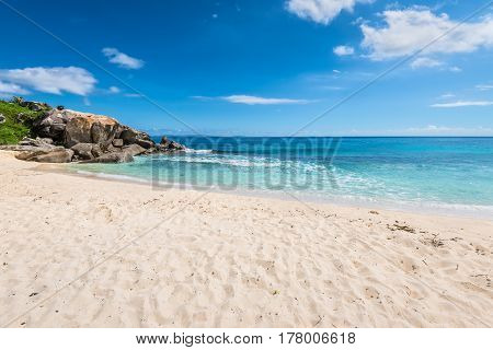 Sunny day on Anse Nord D'Est beach in the north of Mahe Island Seychelles. Anse Nord d'Est is best described as a collection of small beaches spread across two kilometres of coastline on Mahe.
