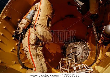 MOSCOW, RUSSIA - JUNE 12, 2016: Russian/USSR astronaut in a spacesuit inside a space station on exhibit at Moscow Space Museum