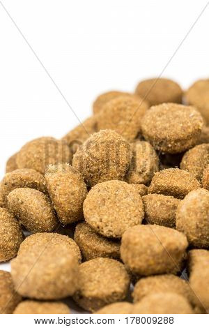 Dog And Cat Food Granules Isolated Over White Background