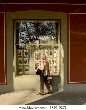 Munich,Germany-March 23,2017: A woman looks at the pictures displayed in the window of a Theatermuseum