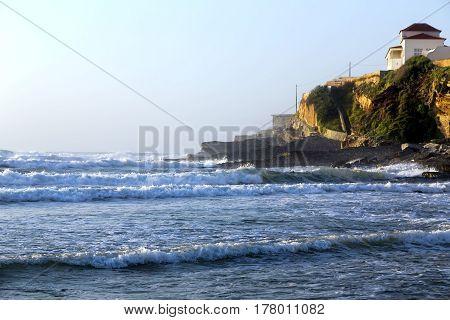 Waves of Atlantic Ocean on Praia das Macas (Apple Beach), Portugal