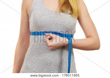 Fitness woman fit girl with blue measure tape measuring her chest under breast size isolated on white