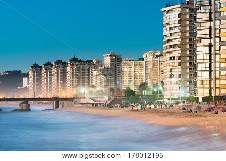 Vina del Mar V Region de Valparaiso Chile - August 15 2016: Acapulco beach the main beach at Vina del Mar gathers a lot of people even in winter season.