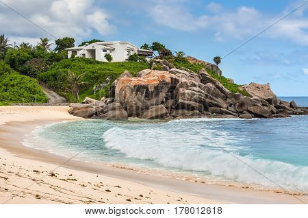 Mahe Seychelles - December 15 2015: Sunny day on Anse Nord D'Est beach in the north of Mahe Island Seychelles.