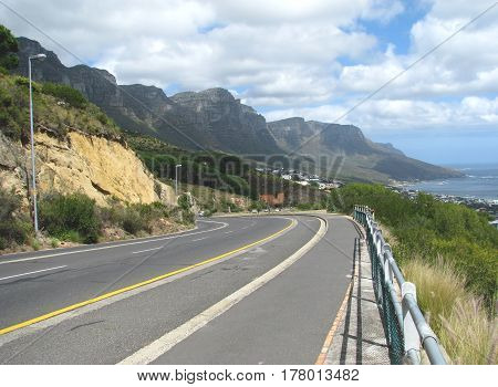 ROAD LEADING DOWN TO CAMPS BAY, CAPE TOWN SOUTH AFRICA17xxcs