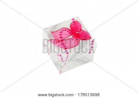 Gift box with pink bow, isolated on white