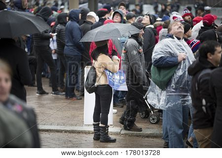45th Presidential Inauguration, Donald Trump: Crowds gather in the rain on the Presidential Parade route, Pennsylvania Ave, NW WASHINGTON DC - JAN 20 2017