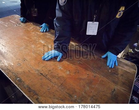 45th Presidential Inauguration, Donald Trump: TSA security at wooden table of a guarded checkpoint near the US Capitol, WASHINGTON DC - JAN 20 2017