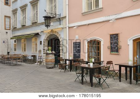 GRAZ, AUSTRIA - MARCH 19, 2017: Nobody at outdoor of restaurant in the old town of Graz the capital of federal state of Styria Austria.