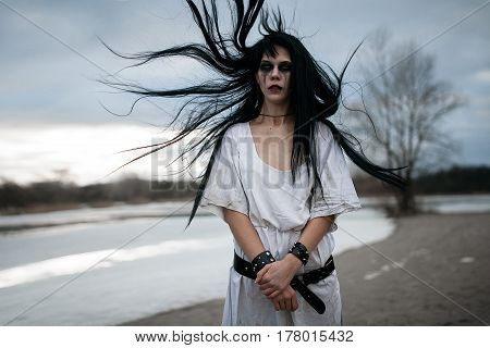 Portrait Of Crazy Young Woman With Hair Blown Up By Wind Near La