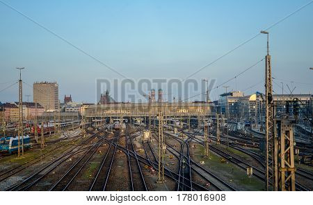 Munich,Germany-March 23,2017:Railroad tracks leaving Munich Central Station with the Liebfrauendom church in the background