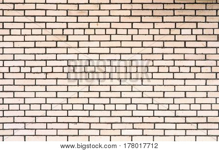 Abstract background of white bricks in the wall