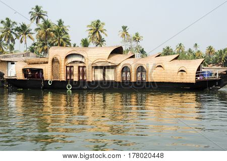 Alleppey, India - 21 January 2015:Traditional Indian houseboat cruising near Alleppey on Kerala backwaters