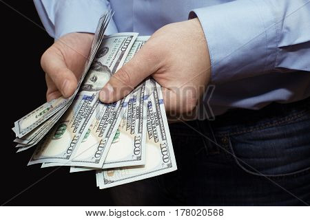 Money in the hands.Businessman offering money. Businessman counting money in hands.