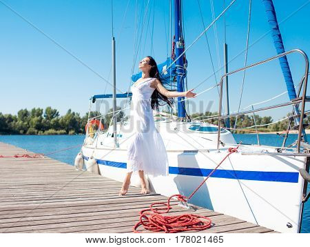 Young beautiful woman on her private yacht