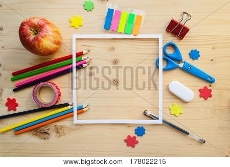 Square Frame With Stationery Flat Lay On Wood Background