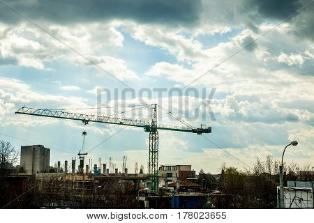 Commercial crane on industrial construction yard. Industrial urban scape