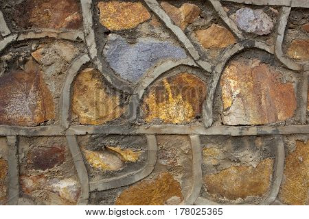 a fancy rustic stone wall background with curved cement seams