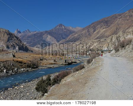 Manang valley and blue Marsyangdi river. Autumn scene in the Annapurna Conservation Area Nepal.