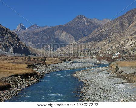 Blue Marsyangdi river. Autumn scene in Manang Annapurna Conservation Area Nepal.