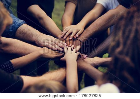 Group of people holding hand assemble togetherness