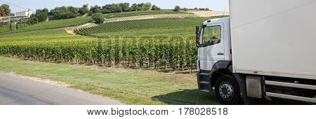 Delivery Truck With A Panorama Of Vines In The Countryside