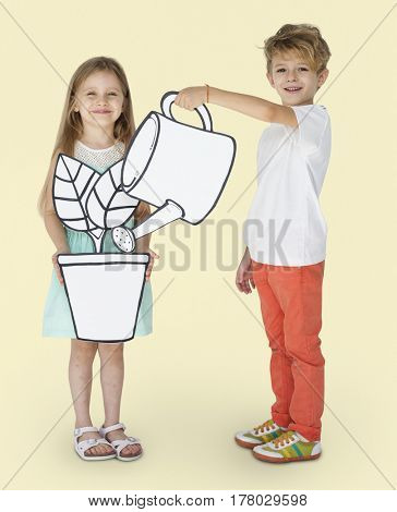 Children watering a plant together